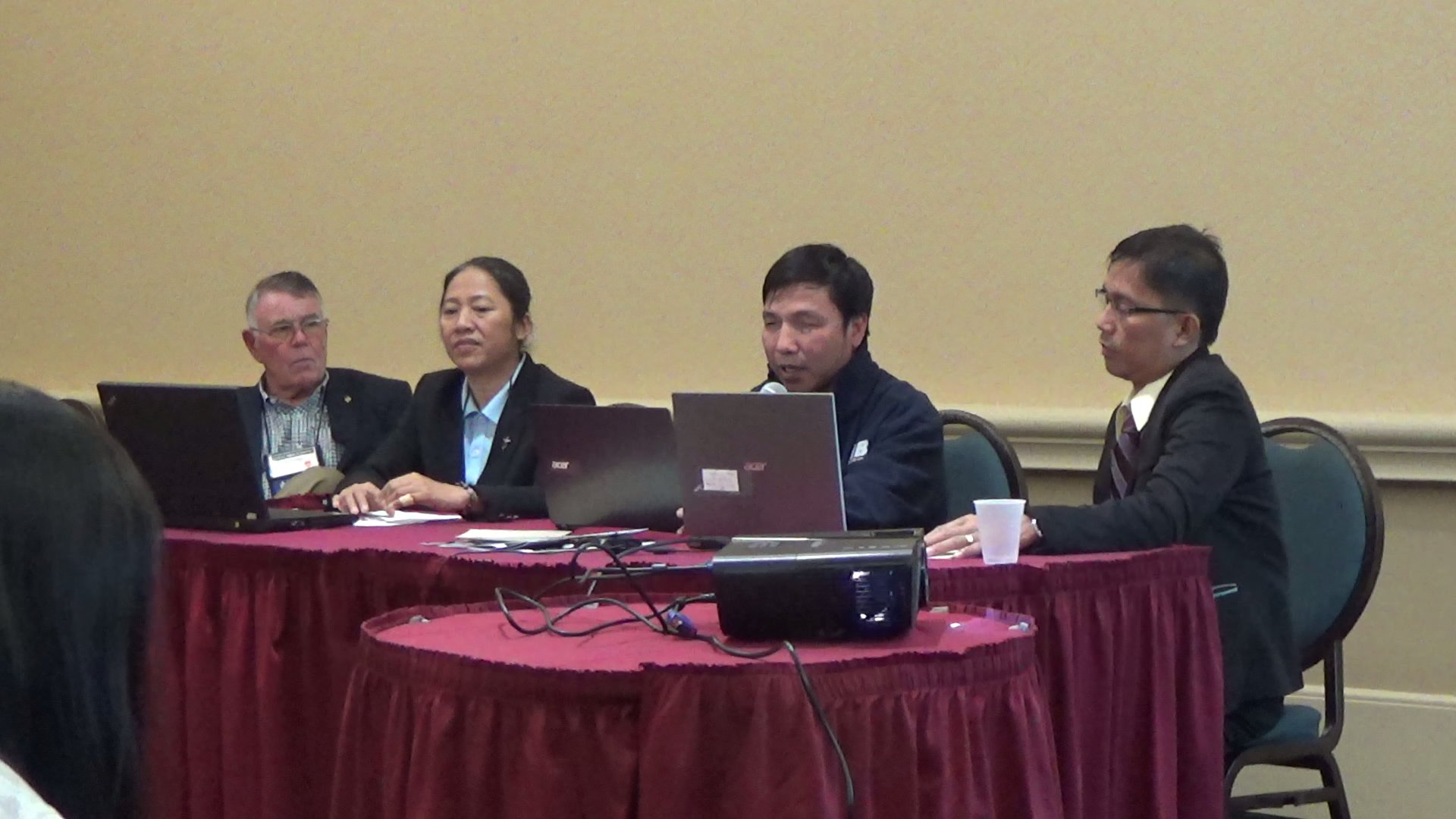 Phuc making presentation with the group of other country coordinators in Orlando